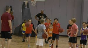 Trojan Men's Basketball Team holds youth camp.