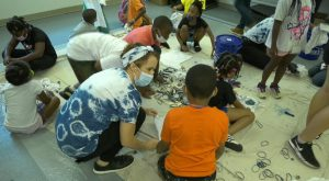 Troy University's International Arts Center shares some ArtSPARK fun with the Boys and Girls Club.