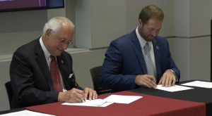 Troy University and Lurleen B. Wallace Community College sign concurrent enrollment agreement.