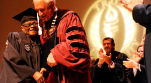 75-year-old completes 50-year journey with Troy University degree