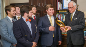 Troy University's ATO president Blake Swicord, with fraternity brothers, present ATO's 2016 Top Chapter Award to Chancellor Dr. Jack Hawkins Jr.