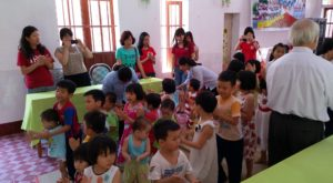 Members of the Troy University Alumni Chapter volunteering at Saint An's Orphanage located in Bui Chu, Nam Dinh City.