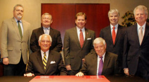 Officials from Troy University and the Alabama World Affairs Council recently signed a partnership agreement.