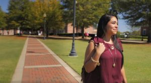 TROY grad Raven Pasibe is the star of a new social media video highlighting all of the ways Troy University feels like home.