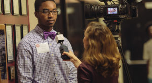 Demetrius Hurry, a student at Foley High School, is interviewed by Troy University's Trojan Vision reporter Samantha Charles.
