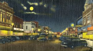 This postcard, depicting a nighttime view of Gadsden's Broad Street, is one of several historic postcards from the Wade Hall Collection.