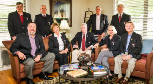 Eric Mizell (seated left) with other members of the Alumni Board, during a meeting this spring. Mizell died on Monday.