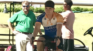Troy University Pi Kappa Phi member Ben Barnett rides a bike for 24 hours during the fundraiser to support Professor Joseph Arnold.