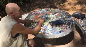 Headland-based artist Frederic Lecut recently turned stone tables at the Dothan Campus walking trail into mosaics.