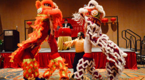 Students from Troy University's Confucius Classroom at LAMP perform the Chinese Lion Dance to begin the Chinese New Year Appreciation Banquet.