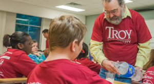 Biology professor Dr. Neil Billington working with area elementary students during the annual  Groundwater Festival at the Troy Campus.