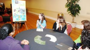 Participants at last year's Hungry for Justice Summit discuss Troy University's Campus Kitchens program.
