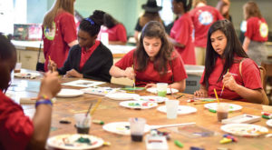 Local middle school students take part in art activities during Trojan Art Day at the Troy Campus.