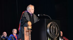 Rod Frazer delivers the keynote address for Spring Commencement exercises on the Montgomery Campus on Monday night.