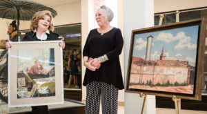 TROY First Lady Janice Hawkins presented the daughter of famed artist Woodi Ishmael with one of his original paintings.
