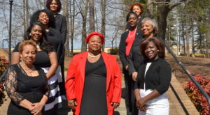 Kimarie Bugg, center, and the staff of Reaching Our Sisters Everywhere. Bugg is a student in the Doctor of Nursing practice program.