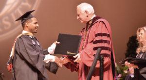 Community leader urges Troy University graduates to help others