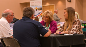 Representatives from Fort Rucker visit with small business representatives during the business matchmaker event.