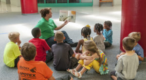 Students take part in story time at a recent Summer Spectacular on the Dothan Campus. The event is one of several camps coming up this summer at TROY.