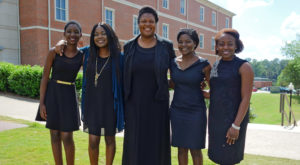 Dr. Lakerri Mack, center, served as a mentor to four recent graduates from Malawi who came to Troy on a scholarship.