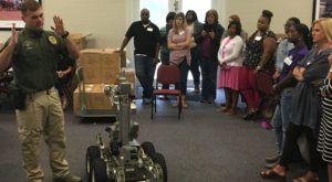 Dothan Police Cpl. Jeremy Conner leads a bomb squad robot demonstration during the Wiregrass leadership academy in Dothan.