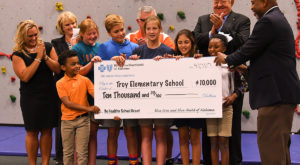 Jeff Adams of Blue Cross Blue Shield of Alabama presents grant check to Troy University and Troy Elementary officials and students.