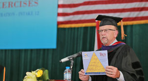 Sun Belt Conference Commissioner Karl Benson speaks to Troy University graduates in Vietnam.
