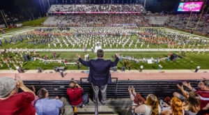 Visiting middle school and high school bands join the Sound of the South on the field at halftime during Band Day at Troy University.