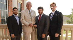 ATO members and Chancellor Jack Hawkins, Jr., holding the Interfraternity Conference's Chapter of Distinction Award.