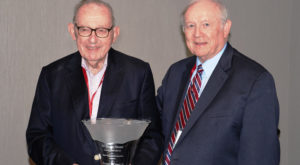 Bradley Currey, Jr. (left) receives the Don Hines Award from Billy Turner, director of TROY's Center for Water Resource Economics.
