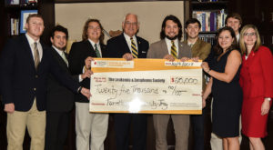 Members of Farmhouse Fraternity at Troy University recently donated $25,000 to the Leukemia and Lymphoma Society to endow a research grant.