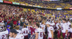 Troy University football players and fans celebrate after Saturday's win over LSU.