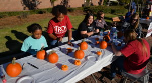 Participants decorate pumpkins with Homecoming themes during Thursday's Homecoming celebration on the Montgomery Campus.