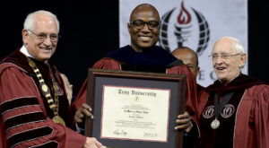 TROY alumnus DeMarcus Ware received an honorary Doctor of Laws degree on Friday after delivering the keynote address to graduates on the Troy Campus.