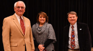 Dr. Jack Hawkins, Jr. and Dr. John Dew present Beth Steed wtih the Vergil Parks McKinley Award on Wednesday during the annual holiday luncheon.