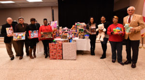 The annual Troy Campus Christmas luncheon collected more than 600 toy donations for area children.