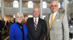 Diane and Curt Porter pose with Dr. Jack Hawkins, Jr., Chancellor, during retirement reception, celebrating Dr. Porter's years of full-time service.