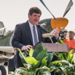 Troy Mayor Jason Reeves speaks at the Tuskegee Army Air Field Hangar dedication.