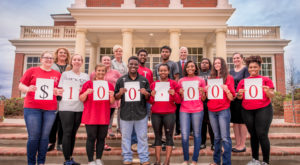Troy University's Annual Giving Phonathon team recently reached a milestone $100,000 in donations.