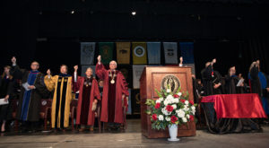 Troy University officials sing the University's Alma Mater during the 2017 Honors Convocation. This year's event is set for April 16.