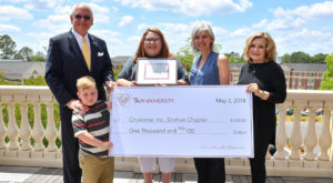Ashley Calloway won a $1,000 check to be donated to Chicktime, a local charity that helps the Alabama Baptist Children's Home in Dothan.