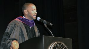 Anthony Brock, head of school at Valiant Cross Academy, challenged graduates to find ways to help and serve others.