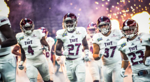 The TROY Trojans take to the field during the 2017 New Orleans Bowl.