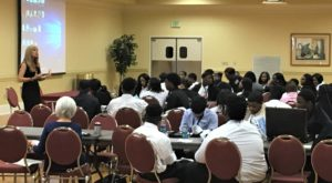 Dr. Carmen Lewis addresses students at the Montgomery Campus Youth Business Summit on April 19.