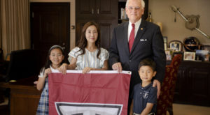 Troy University Chancellor Dr. Jack Hawkins, Jr., with alumna Suyoung Nam and her children Jisu and Jason.