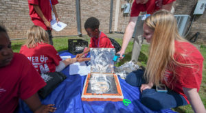 Students at the Boys and Girls Club of PIke County cook s'mores in pizza box solar ovens they built during the Power Up with STEM camp.