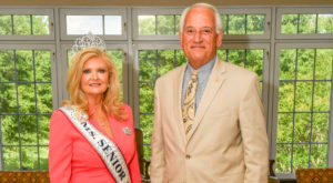 Ms. Senior USA Sara Jo Burks is shown with Chancellor Jack Hawkins, Jr. Burks serves as assistant director of housing and residence life.