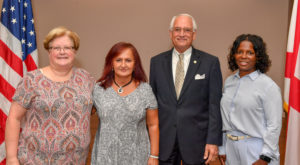 Lisa Ferrell, second from left, of the University's Montgomery Campus was presented with the Vergil Parks McKinley Award during a ceremony on Tuesday.