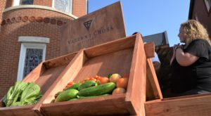 Valiant Cross Academy and Troy University's Montgomery Campus unveiled a farm stand on Monday as the latest part of a community garden project.