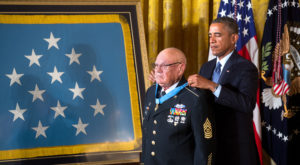 President Barack Obama presents the Medal of Honor to retired Army Command Sergeant Major Bennie G. Adkins during a ceremony at the White House.